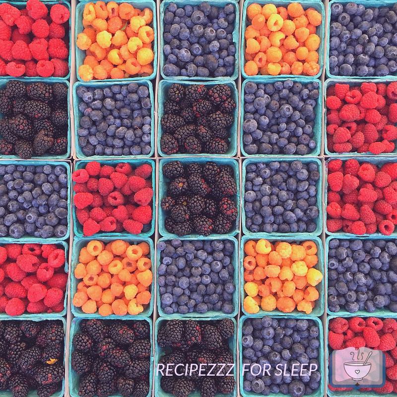 Baskets of various berries in rows